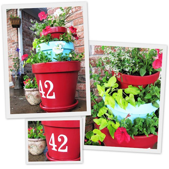 Spray painted pots with house number added! Perfect for a porch!