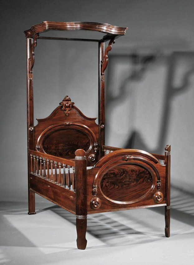 American Rococo Carved Mahogany Half-Tester Child's Bed, Molded Tester With Scrolled And Pierced Crest, Bracketed Posts, Pedimented Headboard With Oval Panel And Applied Bosses, Similar Foot Board, Spindled Rails    c. Mid 19th Century