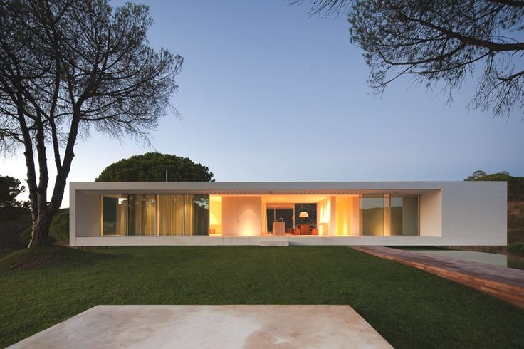 Portugal.  You have to blend minimalist architecture with nature and warm-colored lighting. You are not a robot and this is not 2073.