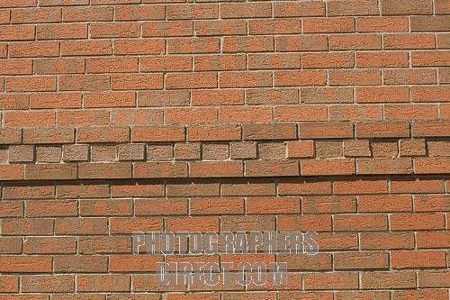 Dentil corbelling providing relief pattern on red brick wall Woodmancote UK stock photo