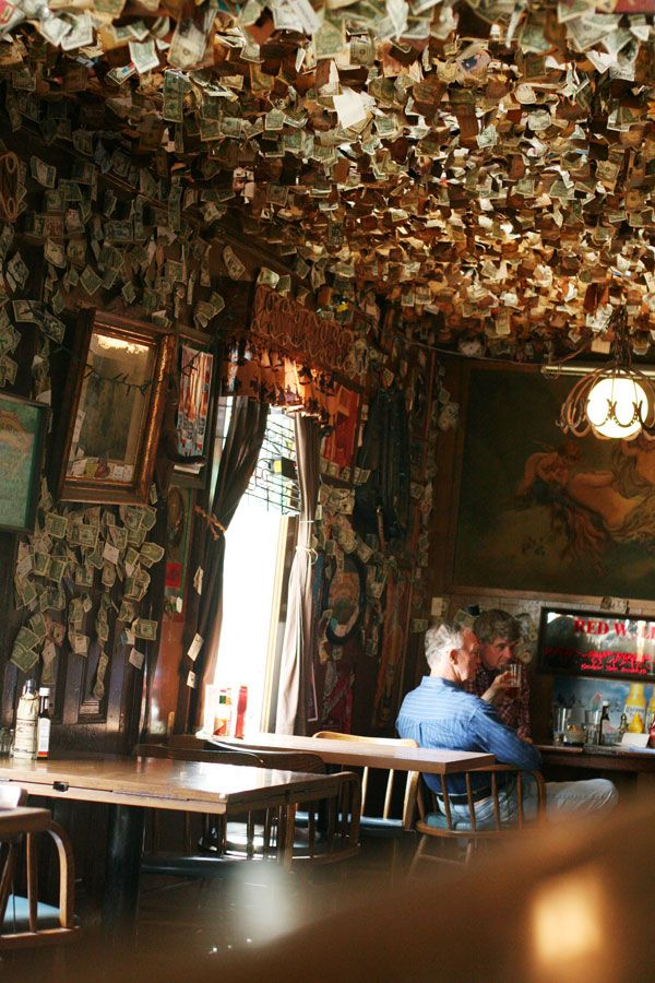 Washoe House in Petaluma, California.    The place has been around since 1859, and used to be a stop on the stagecoach line. Patrons have been writing notes on then tacking dollar bills to the walls for decades, so the bars walls are almost ruffled.
