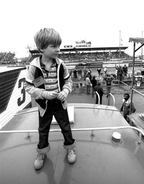 """andyamp88:  """"Dale Earnhardt, Jr., age 6, stands atop a camper watching the 1981 Richmond 400"""""""