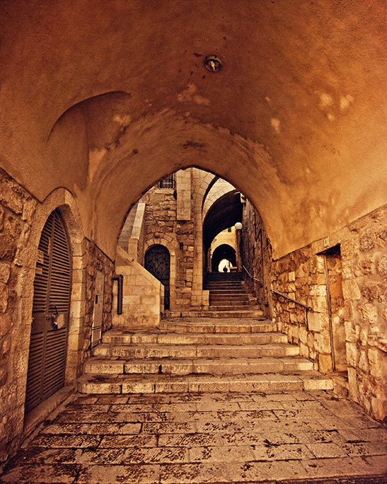 Fine art photograph of a series of stone steps through an arched alley in Jerusalem's Old City by Robin Epstein of Around the Island Photography.