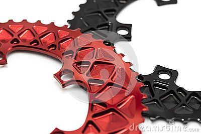Red bicycle chainring in hand