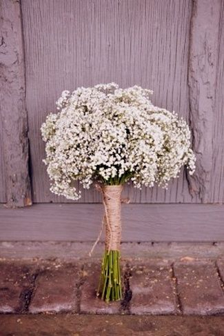 {DIY Tip} Stems of these flowers can be gathered together and secured with elastic bands or string, with the ends neatly trimmed away, leaving a beautiful bush of Baby's Breath on top of the bouquet. To keep the bouquet together, strings of burlap can be strung around the base of the bouquet and a bow tied to end off. | DIY Baby's Breath, Burlap & Lace Wedding Ideas | Confetti Daydreams