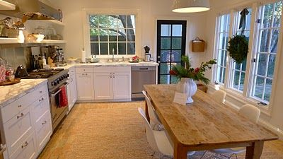 I think I actually prefer the table in the kitchen for a work surface and eating/hangout area rather than an island.  Seems more cozy?