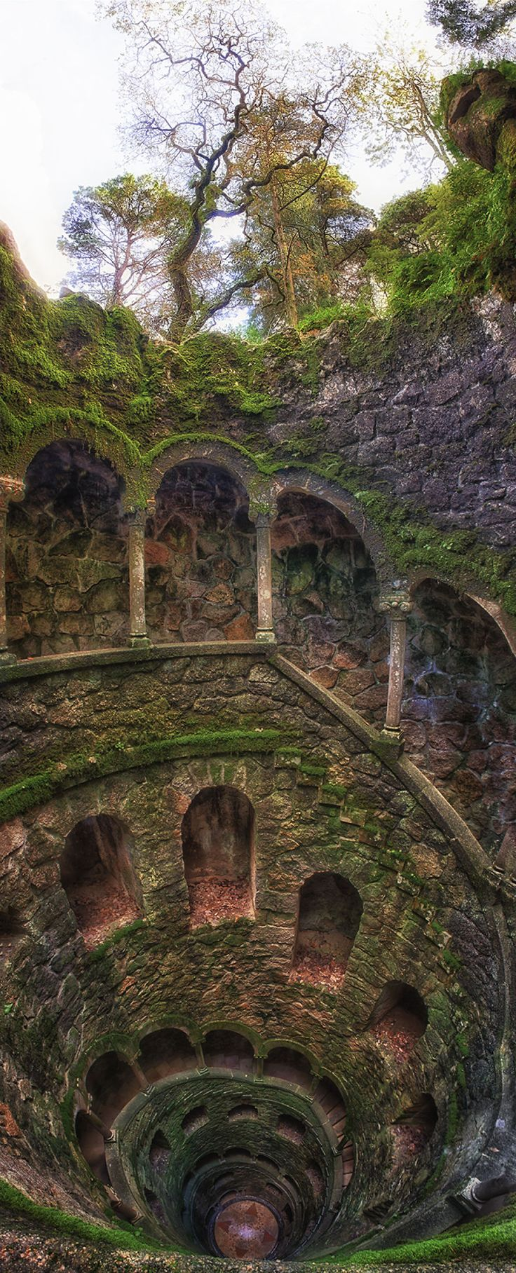 I am a Canadian photographer Taylor Moore. I have captured the magic and mystery of the legendary 'Quinta da Regaleira' located in the UNESCO village of Sintra, Portugal. 'Regaleira' built by (the owner) Antonio Augusto Carvalho Monteiro in conjunction with the renowned Italian opera set designer and architect Luigi Manini. These two noblemen conspired to create a place of divine magic and mystery embodying a combination of styles including Roman, Gothic, Renaissance and Manueline.