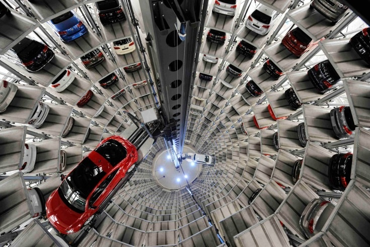 "March 12, 2012. A Volkswagen ""Beetle"" (R) and an ""UP!"" are pictured in a delivery tower at the company's headquarter in Wolfsburg, Germany."