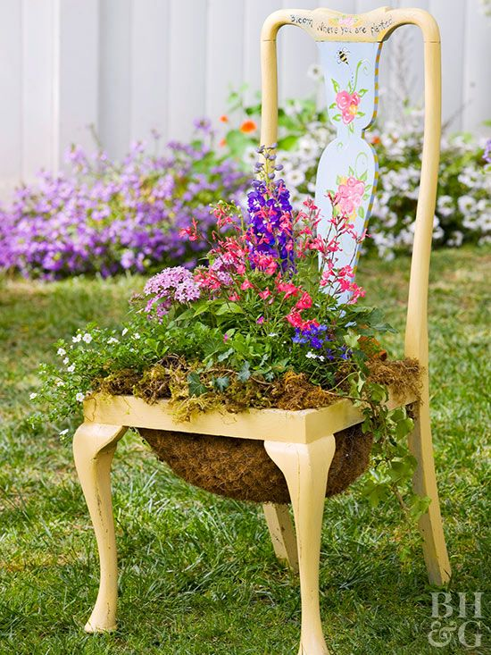 Repurpose an old chair into a statement-making garden planter full of your favorite flowers! #chairplanter #diy #upcycledchair