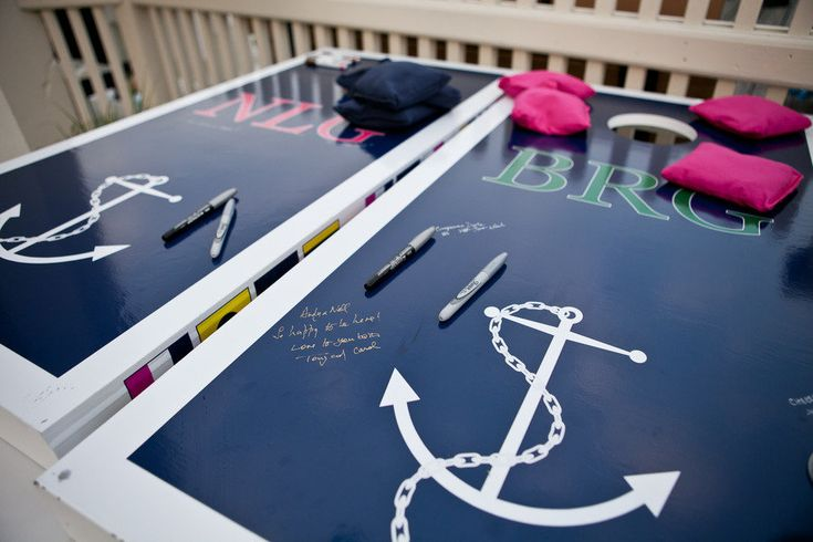 cornhole boards instead of a guestbook. omg love this.