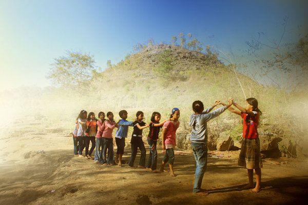 "Traditional game from Indonesia, ""Ular naga"" (Dragon Snake)."