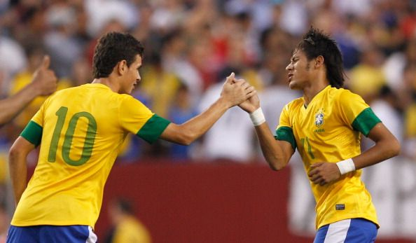 Neymar #11 (R) of Brazil celebrates with teammate Oscar #10 after Neymar scored the first goal against USA during an International friendly game at FedExField on May 30, 2012 in Landover, Maryland