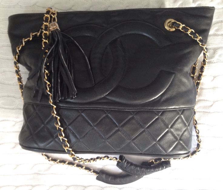 Large vintage 1970s Chanel quilted black kid leather bag with logo