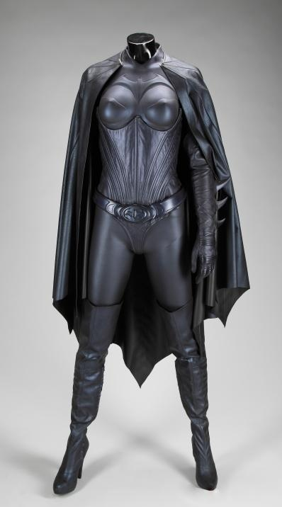BATGIRL COSTUME FROM BATMAN & ROBIN - A dark blue Batgirl costume worn in Batman & Robin (Warner Bros., 1997) by Alicia Silverstone, who played Batgirl, consisting of a leather bodysuit with foam breastplate and shoulders with stylized Batgirl logo. Also included are elbow-length gloves. Completing the costume is a knee-length leather cape with distinctive Winning bid:$ 12,800 Jul2011