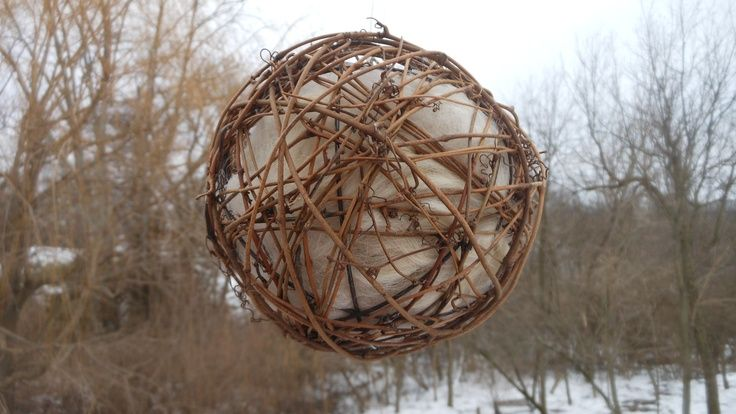 """Pamper your birds with a 6"""" grape vine ball filled with llama or alpaca fiber, your choice. Hang it from a branch, hook, or wherever you want and birds will pull the fiber out to use in their nests - they love it!  Balls are refillable and make great gifts!"""