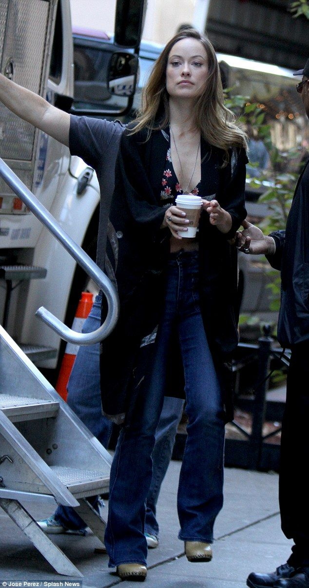 Bohemian style: Olivia Wilde picked up the tempo in a low-cut floral crop top and long cardigan on the NYC set of HBO's forthcoming '70s era series Vinyl on Tuesday