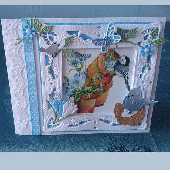 Handmade card by Alie de Blieck with Creatables Petra's Square with Nest (LR0458), Petra's Circle with Bird ( LR0457), Butterfly Border (LR0456), Tiny's Crocus (LR0400) and Fence (LR0205) from Marianne Design