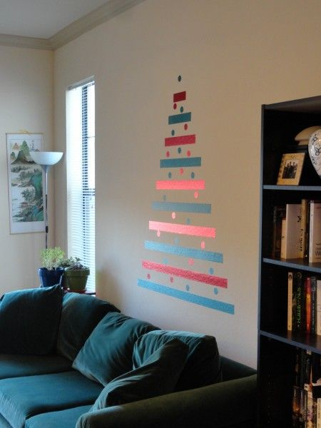 Cat-friendly crafty and abstract alternative christmas tree - just use a couple rolls of removable wall tape, a circle hole puncher, and get creative!