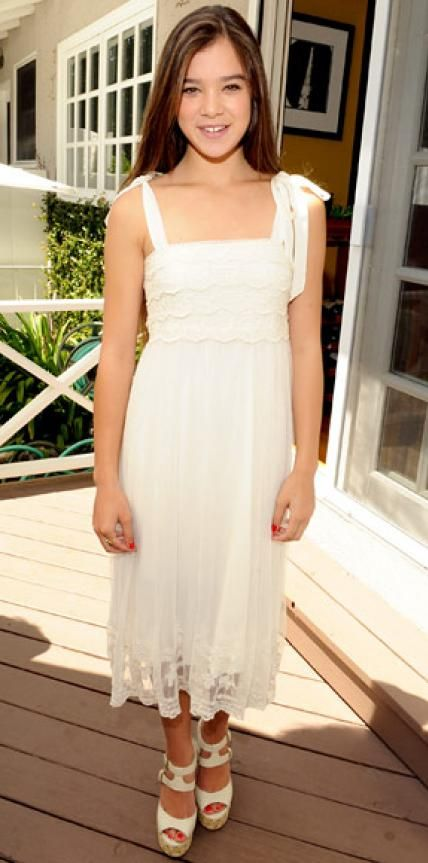 Look of the Day › August 16, 2011 WHAT SHE WORE At the Day of Indulgence, Steinfeld accessorized her lace H&M LWD with peep-toe Nine West platforms.