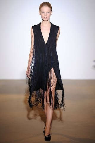 Jil Sander Spring 2009. Fringe were added to tailored looks, thus giving a 1920s appeal, the 21st century equivalent of the 1920s speakeasies.