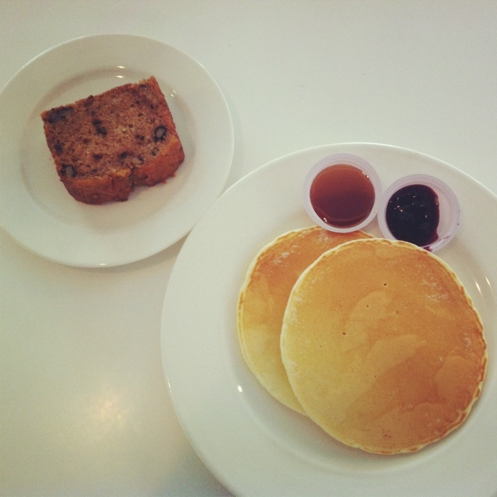 ... fruit & nut cake with some pancakes accompanied by blueberry
