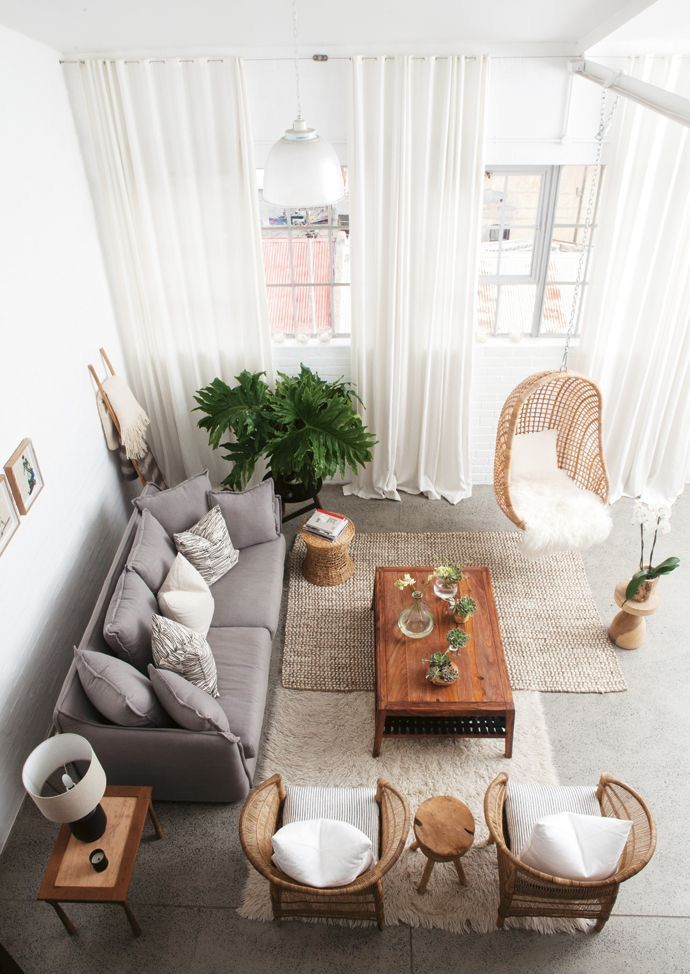 home design / living room / bohemian design / white walls / bright interiors / gray couch / hanging chair