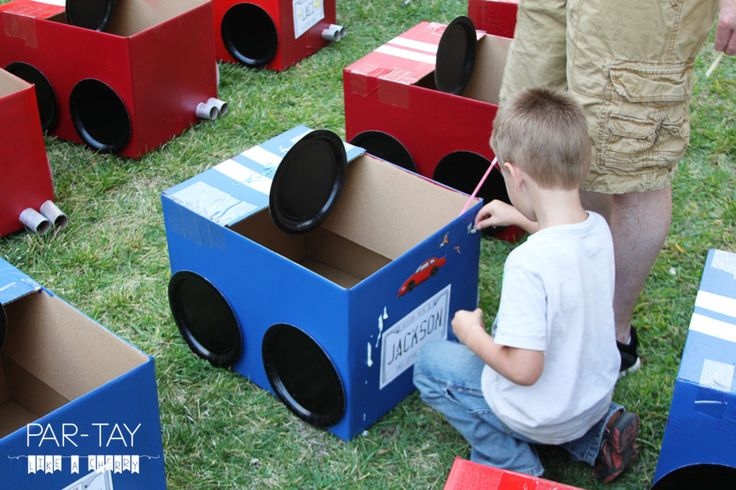 decorating cardboard box cars at drive in movie party