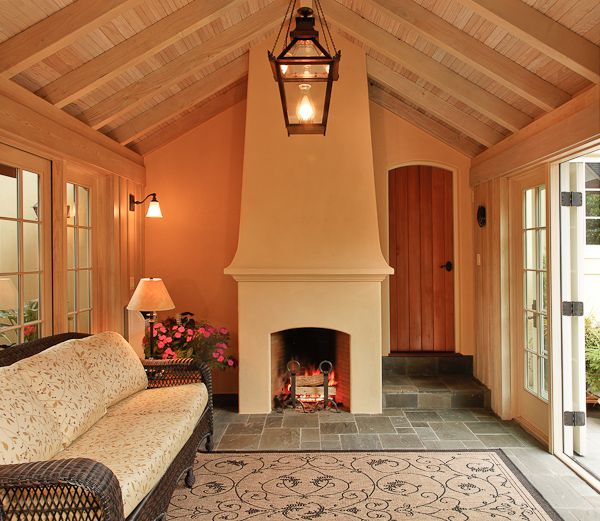 Sunroom Has A Vaulted Ceiling With Exposed Beams And A