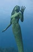 Amphitrite mermaid statue by Simon Morris, by Georgetown, Grand Cayman (****Duplicate Pin; See close-up view above.)
