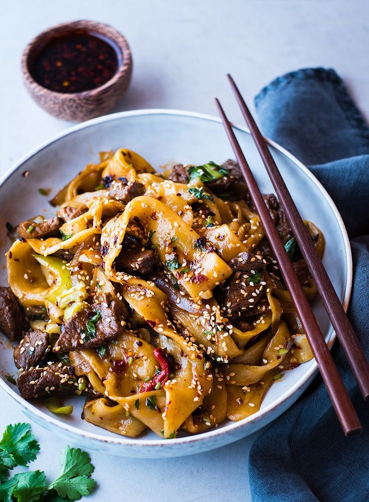 Freshly made Chinese-style hand-pulled noodles served with spicy stir-fried cumin lamb and fresh coriander.