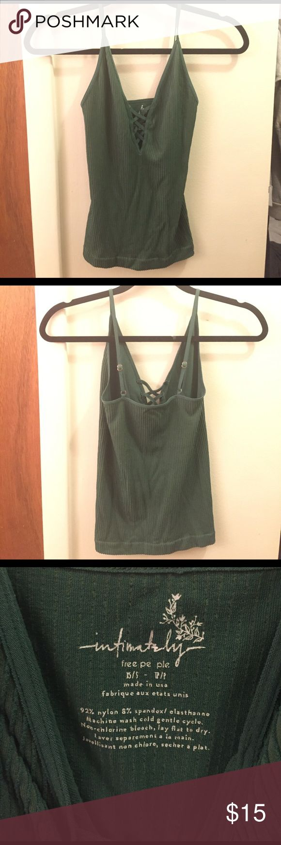 Green Criss-cross V-Neck Cami Tank Top Stretchy green cami/tank top from Free People Intimates. Size XS/S. Great condition, never been worn. Would go great with jeans or a cute skirt. Free People Tops Camisoles
