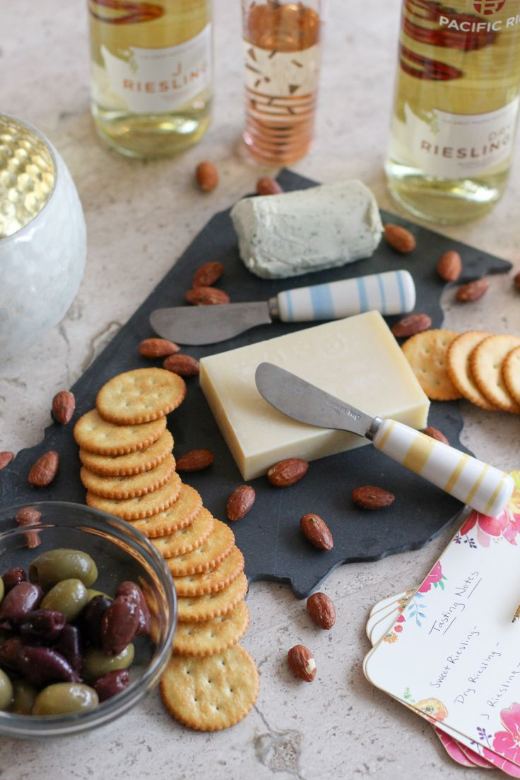 Try something new at your next wine and cheese night with a riesling flight! Read this post for how to prepare a cozy wine night in! Expect tons of cheese! #winenight #cheese
