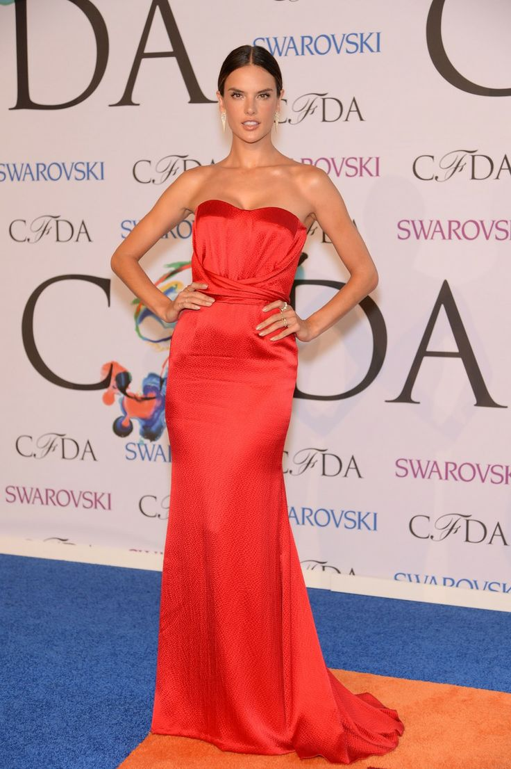 See All the Red Carpet Looks From the 2014 CFDA Awards Alessandra Ambrosio wore a red halter dress by Nonoo and jewels by Jennifer Fisher.