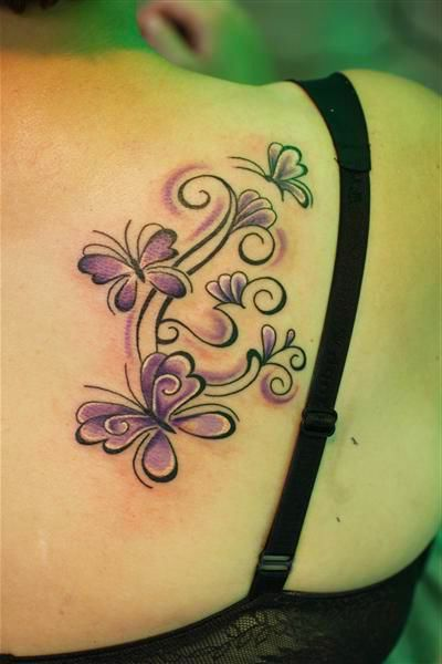 pretty butterfly tattoo on the back. For more exciting tattoos visit www.tattooenigma.com