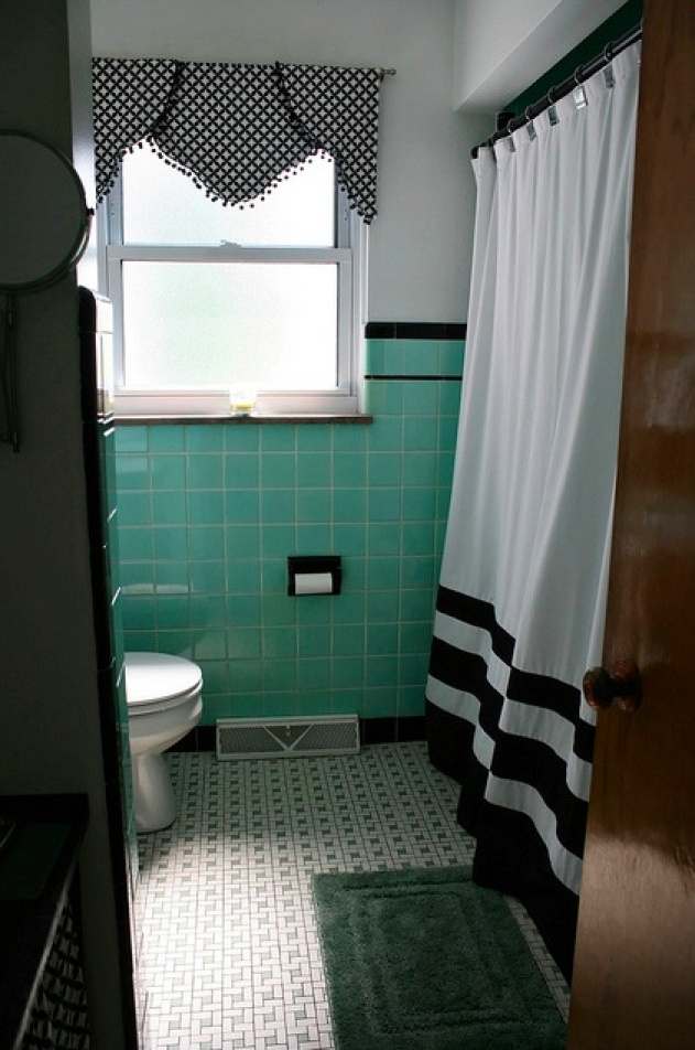 Seafoam green and black trimmed tile walls with a black and white pin wheel mosaic floor, found in a mid century original bathroom. ----Closest example of what our bathroom actually looks like....