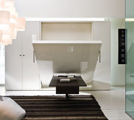 Ulisse Dining    The Ulisse Dining Space Saving System consists of a Queen wall bed with a 4 1/2 foot dining table on the front that ingeniously remains parallel to the floor as the bed is opened, so items can be left on the table even when the bed is down.