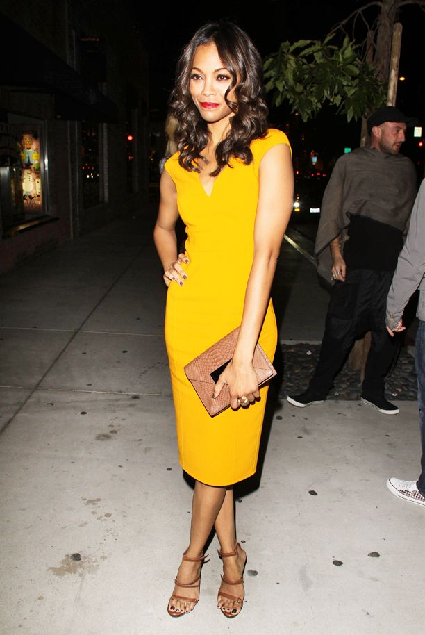 (Love the color of this dress) Zoe Saldana and a male companion at the Michael Kors party in Beverly Hills, Calif.