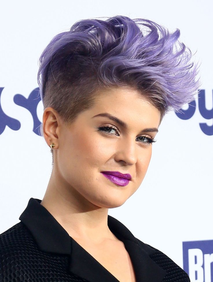Kelly Osbourne is rock-star perfection with her purple mohawk. So funky!