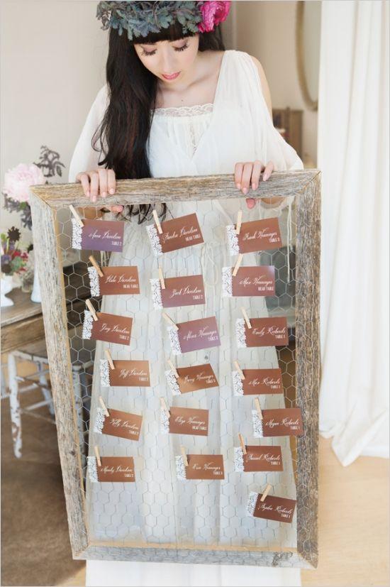 framed chicken coop wire escort card display #diy #escortcards #weddingchicks http://www.weddingchicks.com/2014/03/21/bright-bold-berry-wedding/
