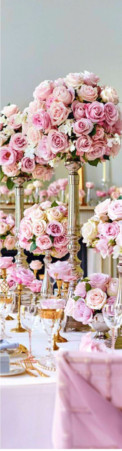 Roses and silver table centerpiece