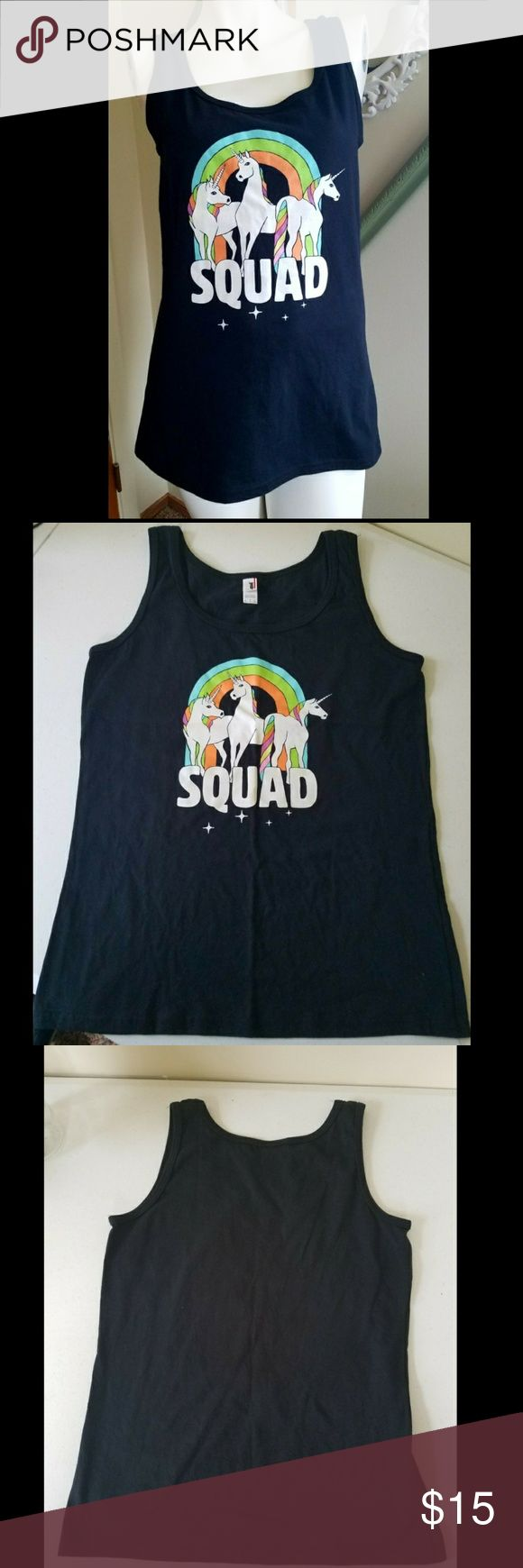 "SQUAD T-shirt What's better than a SQUAD of unicorns. Black tank top with front logo. NWOT. 100% cotton. Preshrunk fabric. Semi fitted.   Measurements  Length 26""  Width 17""  Strap width 2""  Get an additional 30% off when purchasing 3 or more items using the bundle feature. Always willing to negotiate. Make an offer. Anvil Tops Tank Tops"