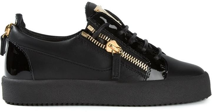 $665, Black and Gold Low Top Sneakers: Giuseppe Zanotti Design Side Zip Detail Sneakers. Sold by farfetch.com.