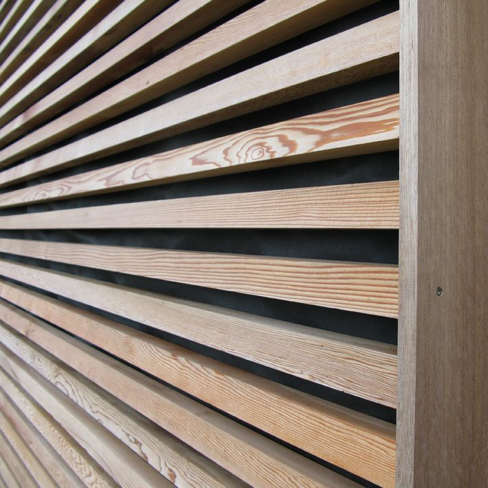 French motorway services Building with Larch cladding & western red cedar doorway detail - English Woodlands Timber