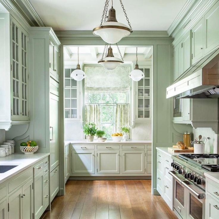 beautiful minty green kitchen by Victoria Hagan. She always gets the mix just right.    #Regram via @onekingslane