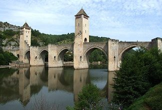 Cahors, France: A diffrerent view of the Pont Valentré medieval bridge. The bridge is 172 meters long and has 8 arches. Every year a fireworks show takes place on the Pont Valentré on the evening of July 13th. This is a special spectacle that you must  see once. A visit to this special bridge is absolutely worth it, and can be perfectly combined with a visit to the city of Cahors.