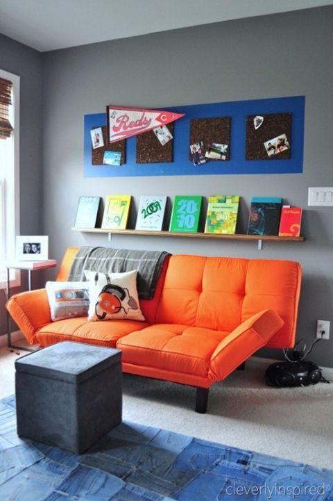 hangouts for preteen boys bookself orange futon corkboard photo organizer, cleverly inspired @remodelaholic