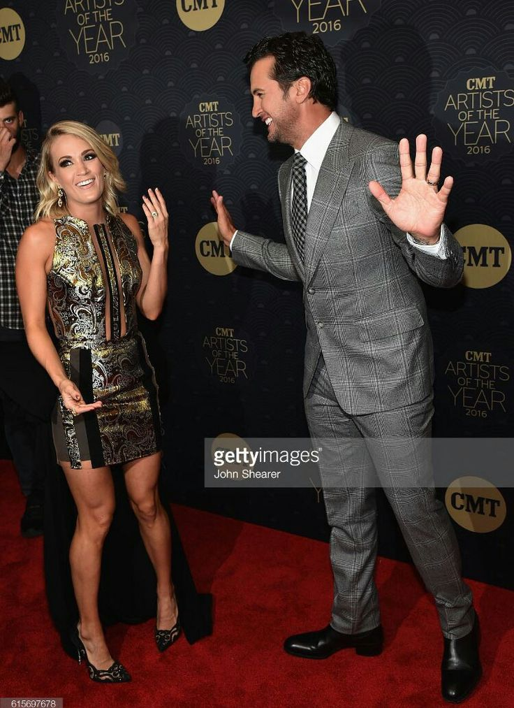 Carrie with Luke Bryan on the red carpet at the CMT AOTY's