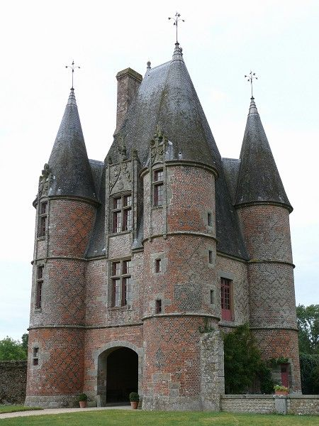 Châtelet d'entrée, Château de Carrouges, Ornes, France -  The 16th century châtelet, or gatehouse, comprises four circular turrets, and was probably built by Jean Le Veneur. It is constructed of red and black bricks.