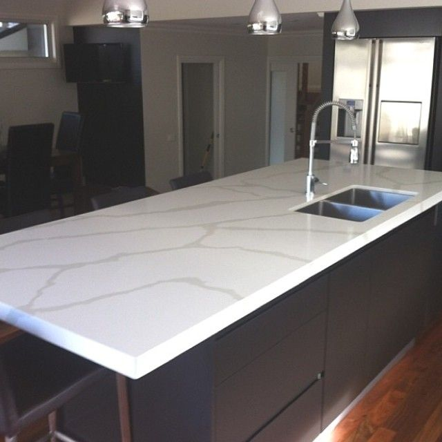 Calacutta quartz from Quantum Quartz - benchtops completed by Granite Planet in Upwey.   Kitchen island bench is bookmatched.