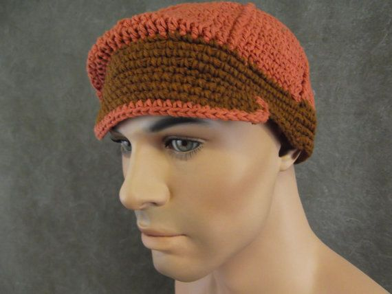 Average size up to 22 circumference   Try a jaunty little unisex baseball cap for Spring and Summer casual wear! This one, in a rich rusty color accented with a chocolate brim and band, is the perfect accessory for casual wear. It is crochet of 100% cotton yarn.  Care: Hand wash in cold water. Dry on permanent press cycle.